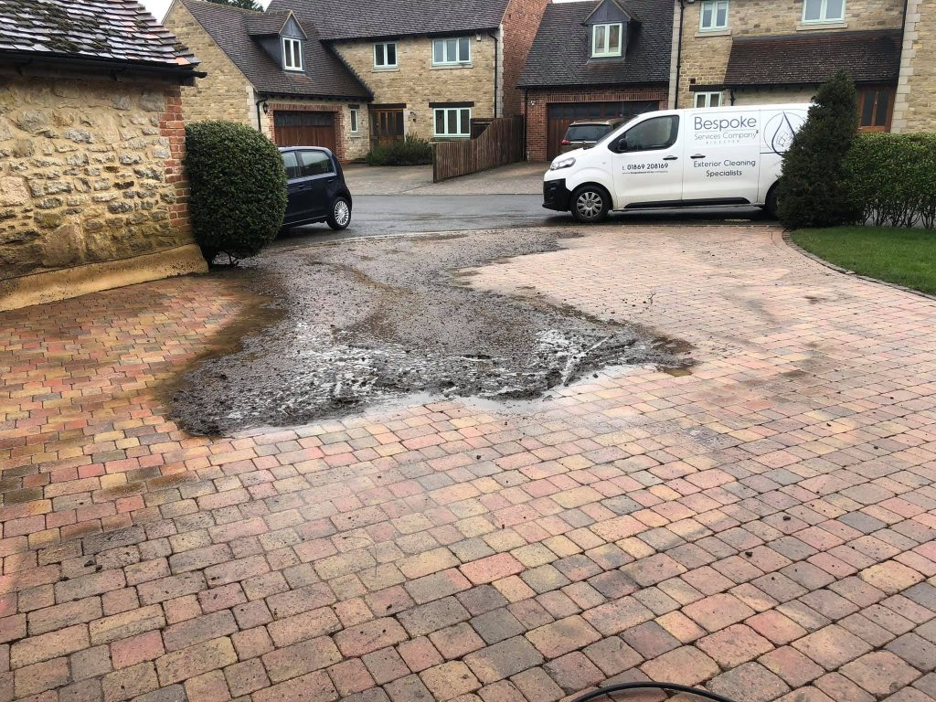 Block paving in Bicester, with dirt collected in one area.